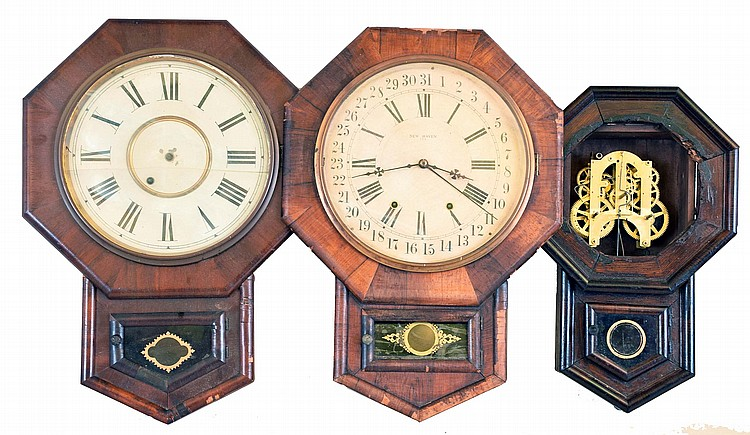 Clocks- 5 (Five): (1) New Haven Clock Co., New Haven, Conn., Short Drop wall hanging clock with a spring driven 8 day time, strike and simple calendar movement in a rosewood veneered case, c1890. (2) New Haven Clock Co., New Haven, Conn., Short Drop
