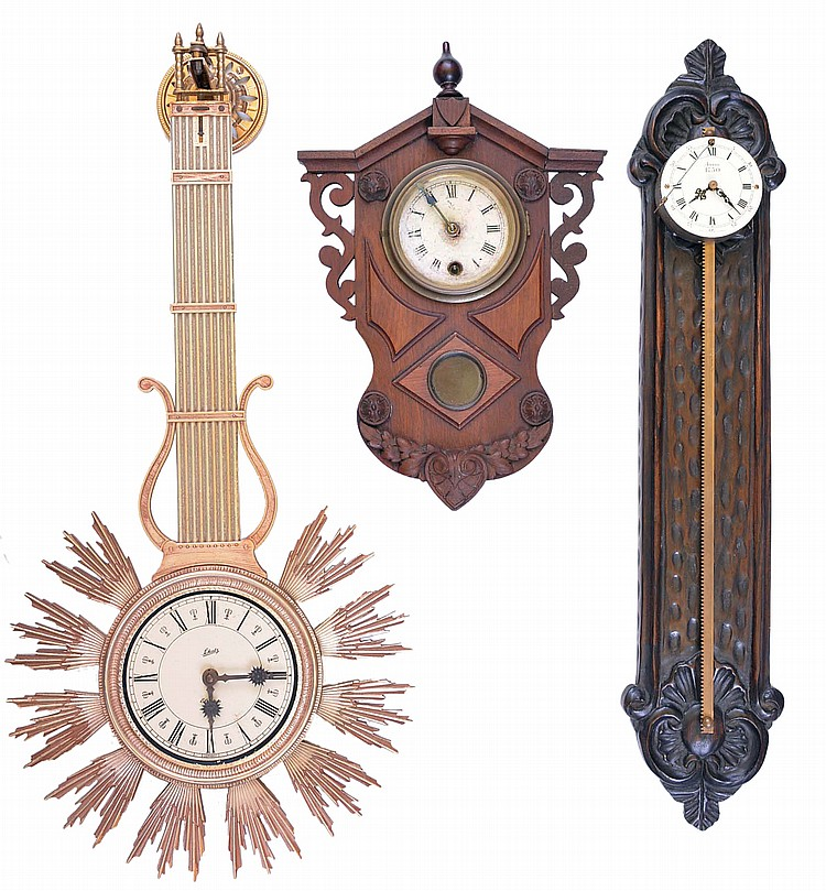 Clocks- 3 (Three), a 20th century gravity clock, a plastic, a 20th century battery operated Schatz swinging clock, and a small Gilbert wall clock, late 19th century