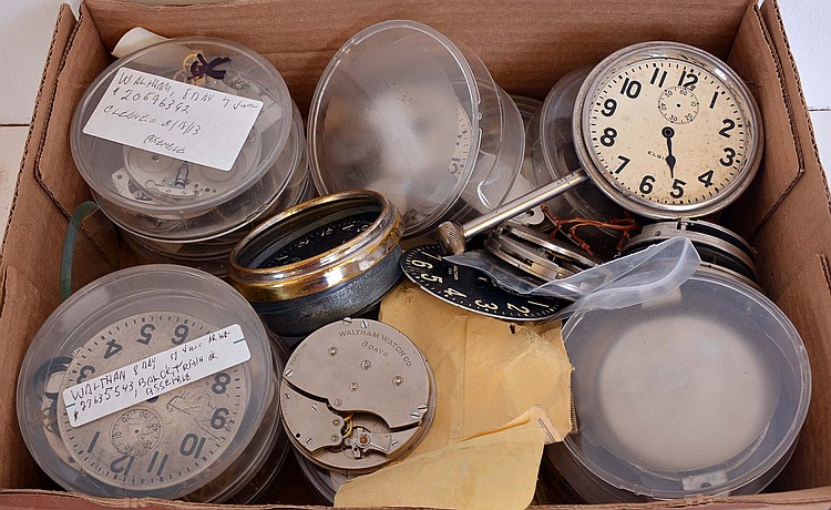 A box of Waltham and Elgin automobile clocks and parts, together with a shop made transmission pulley for lathe accessories