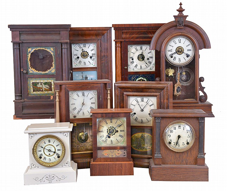 Clocks- 9 (Nine): (1) Seth Thomas Clock Co., Thomaston, Conn., shelf clock with a 30 hour spring driven time and strike movement in a rosewood case, c1890. (2) Ansonia Brass Co., New York, NY, shelf clock with an 8 day spring driven time and strike