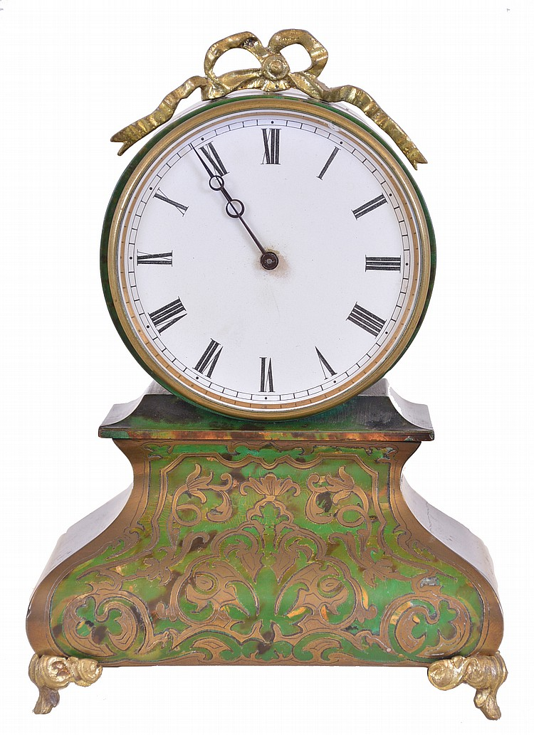 France, desk clock, ebonized case with bombe base on case feet supporting a drumhead case with cast, bowknot ornament, front of base with underpainted horn veneer and brass inlay, Roman numeral glossy card stock dial, blued steel Breguet style hands,