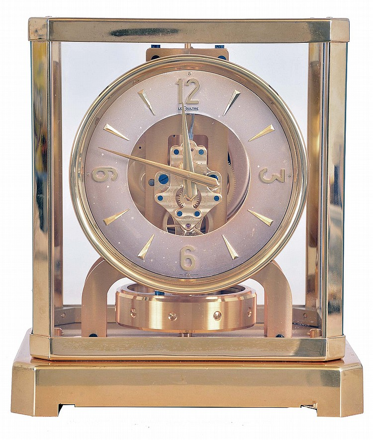 LeCoultre, Switzerland, Atmos clock, glazed, gilt brass case, silvered Arabic numeral and arrow marker dial, 15 jewel caliber 519 movement, serial #37110