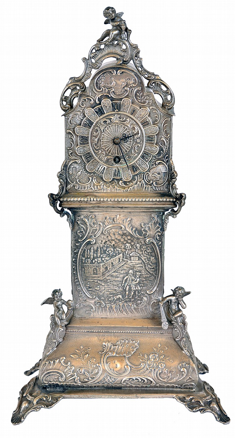 Desk clock in miniature tall clock form, silver case with bombe base and arch top, decorated with rococo style, repousse ornament, and with three cast putti, containing a thirty hour, continental verge fusee watch movement, 19th century