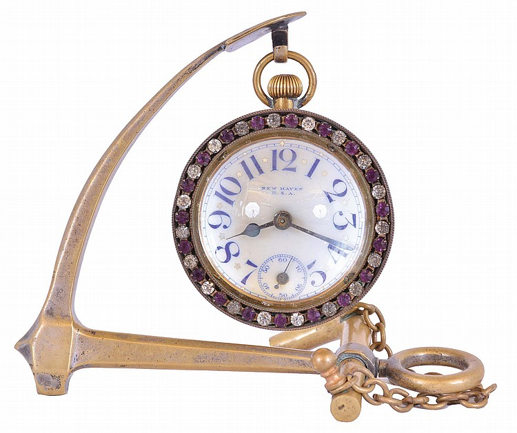 New Haven Clock Co., New Haven, Conn., desk clock with stand, the ball form timepiece with brilliant set bezel, Arabic numeral white enamel dial, and 30 hour pin lever movement, with anchor form brass stand