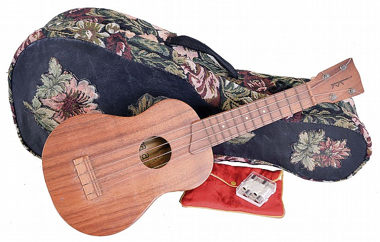 Kamaka Ukulele, Inc., Hawaii, a koa ukulele with soft shell case