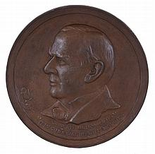 William McKinley commemorative plaque, cast iron with bronze finish, with bas-relief of the late president in profile, and marked copyright 1901 by Edwin C. Kruger
