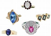 Rings- 5 (Five), 14 karat yellow and white gold, the first with an oval opal surrounded by 12 small garnets, size 6, the next set with an oval amethyst, size 9, the third with three emerald cut peridot, size 5, the fourth with marquise cut blue