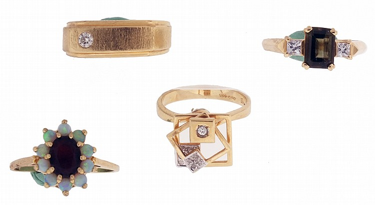 Rings- 4 (Four), all 14 karat yellow gold, the first set with a central garnet, surrounded with 10 small opals, size 10, the next with emerald cut tourmaline with a pair of flanking colorless spinel, size 8, the third set with small diamonds, the