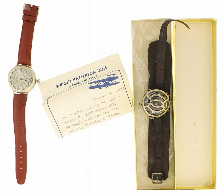 Wrist watches- 2 (Two), the first Swiss, 15 jewel nickel movement, luminous Arabic numeral black enamel dial, nickel case with wire lugs and crystal guard, with early, possibly original leather strap, and a brief note stating that the watch was worn