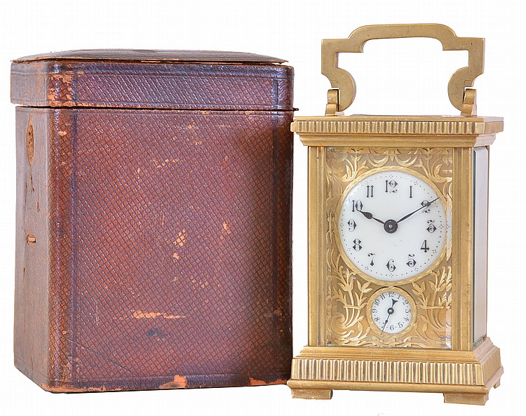 France, carriage clock, rectilinear gilt brass case, with reeded base and frieze, gilt, pierced and engraved dial mask, Arabic numeral white enamel dial, blued steel spade and poker hands, 8 day timepiece movement with alarm and cylinder platform,
