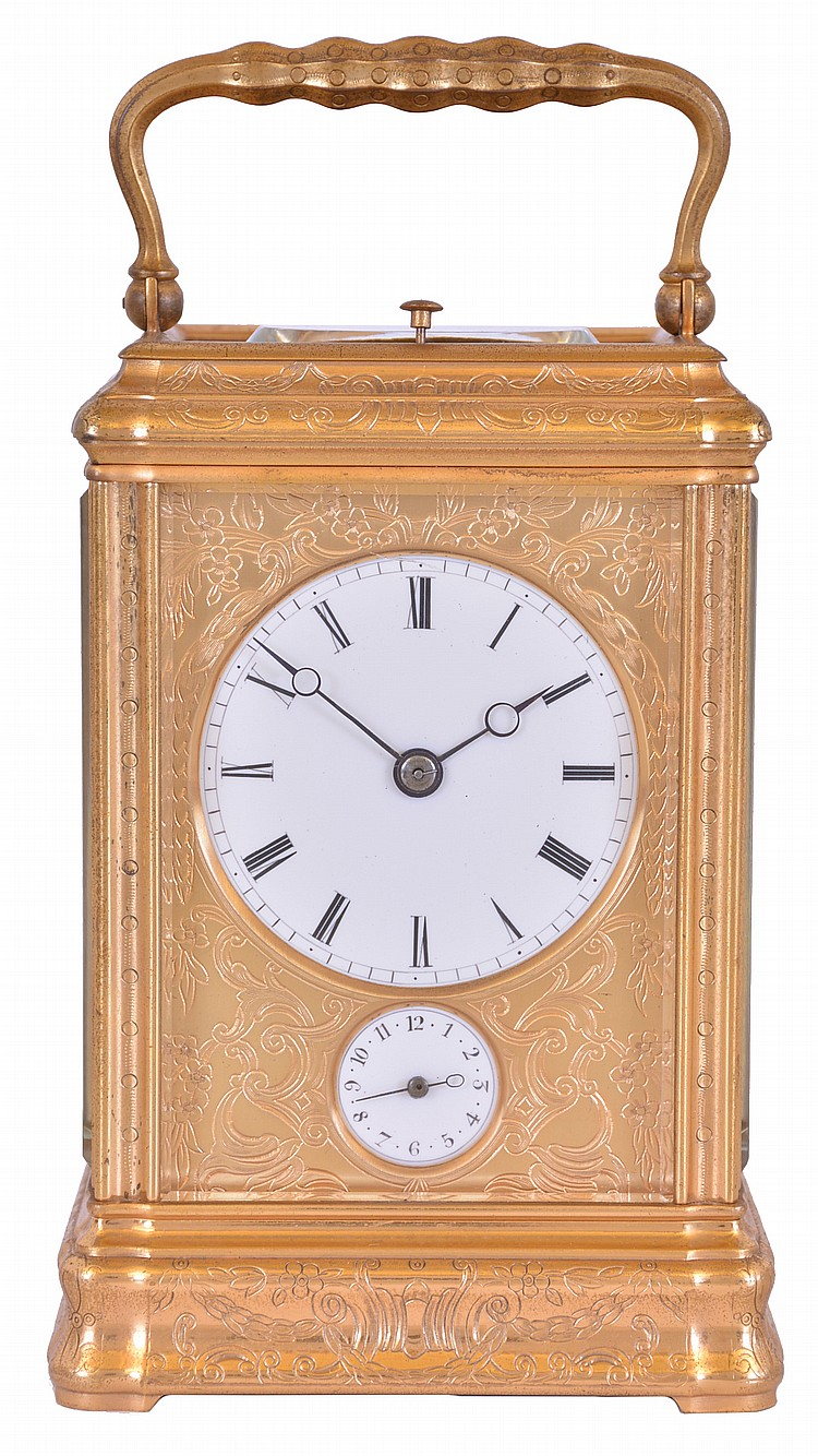 France, hour repeating carriage clock, engraved, gilt Gorge case with beveled glasses, the back door also with engraving and shuttered apertures for winding and setting, white enamel dial with gilt, engraved mask, blued steel Breguet style hands, 8