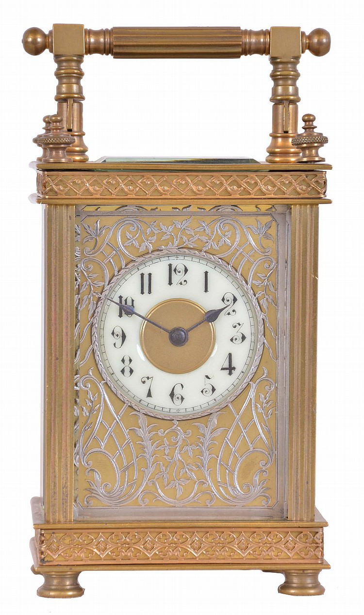 France, carriage clock, rectilinear gilt brass case, with pierced fret trimmed base and frieze, silvered, pierced and engraved dial mask, Arabic numeral white enamel dial, blued steel spade hands, 8 day timepiece movement with lever platform