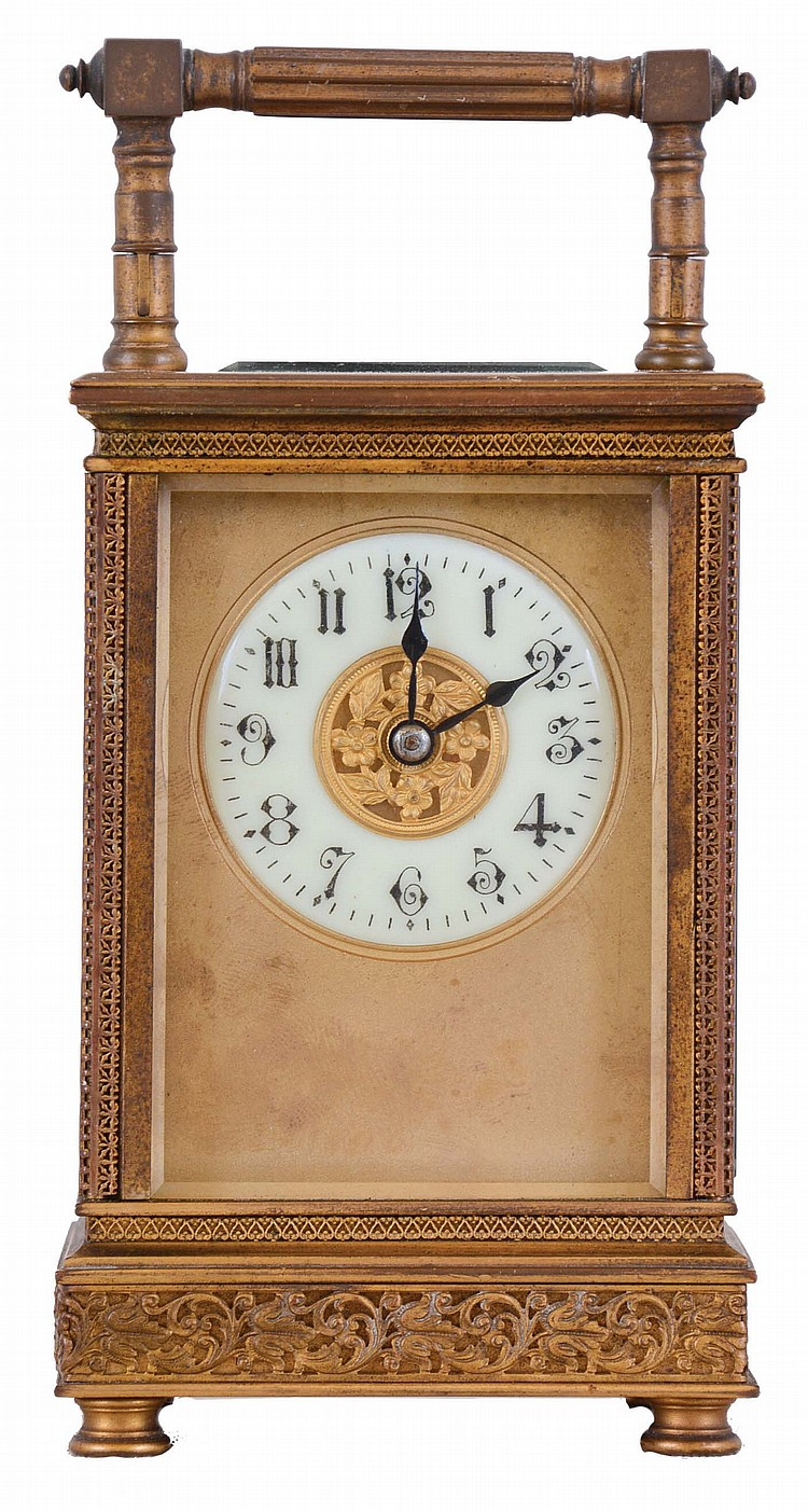 France, carriage clock, gilt case decorated with pierced frets of various design, Arabic numeral white enamel dial with gilt mask, blued steel hands, 8 day time and strike movement with lever platform
