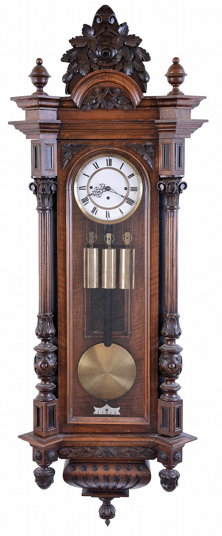 Austria, a large grand sonnerie hanging regulator, walnut case with carved and turned ornament, large base and cornice moldings, and foliate carved crest, Roman numeral two piece white enamel dial, 8 day, weight driven, three train quarter striking