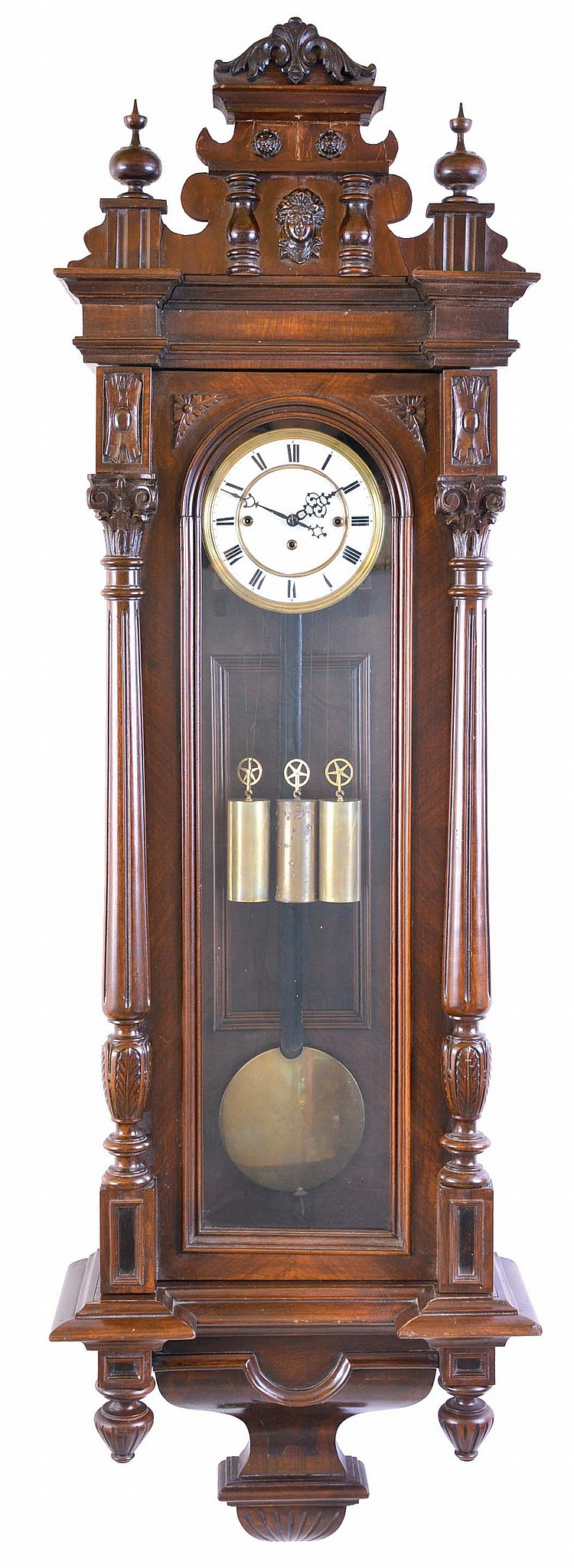 Austria, grand sonnerie striking regulator, beech and walnut case, door with fluted and carved columns, molded top with removable crest, and base with veneered bracket and turned drops, Roman numeral, two piece white enamel dial, blued steel hands, 8