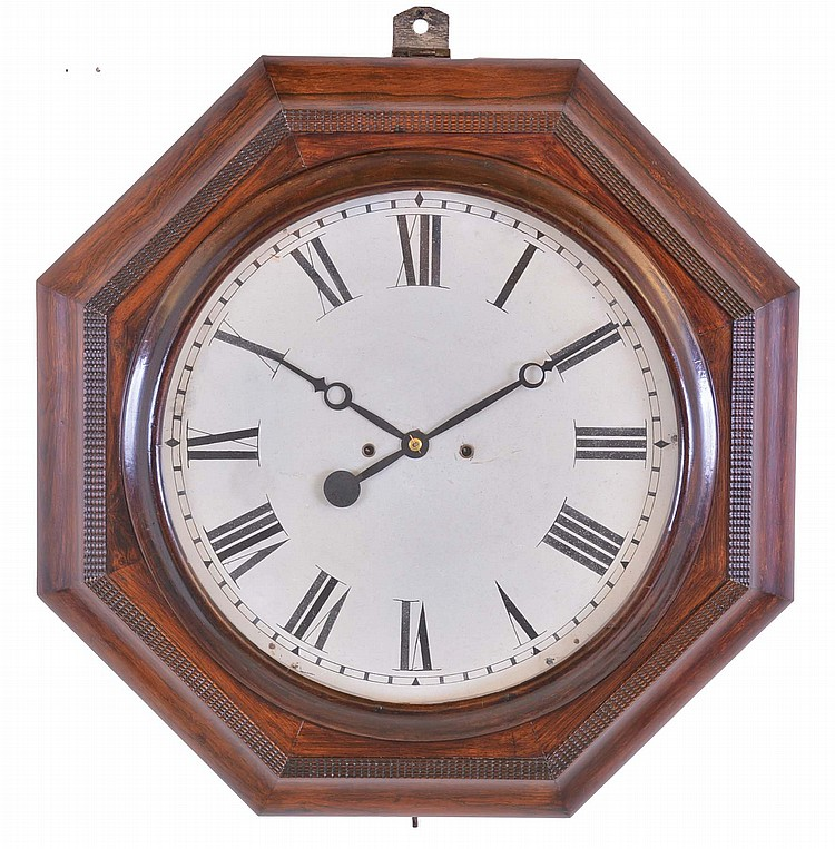 Atkins Clock Co., Bristol, Conn. Gallery wall clock with a spring driven 30 day double fusee timepiece movement in a rosewood veneered case with ripple front molding.