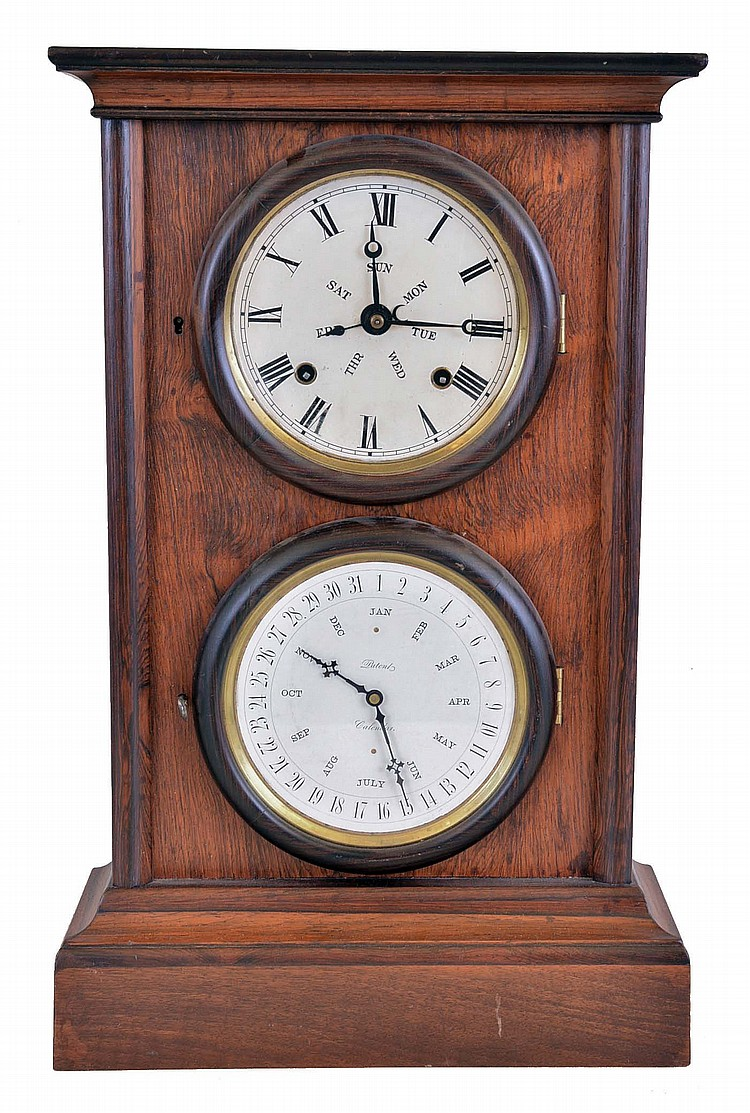 L.F. & W.W. Carter, Bristol, Conn., 8 day, time and strike spring brass movement double dial calendar shelf clock with a B.B. Lewis patent calendar manufactured by Elias Burwell, Bristol.