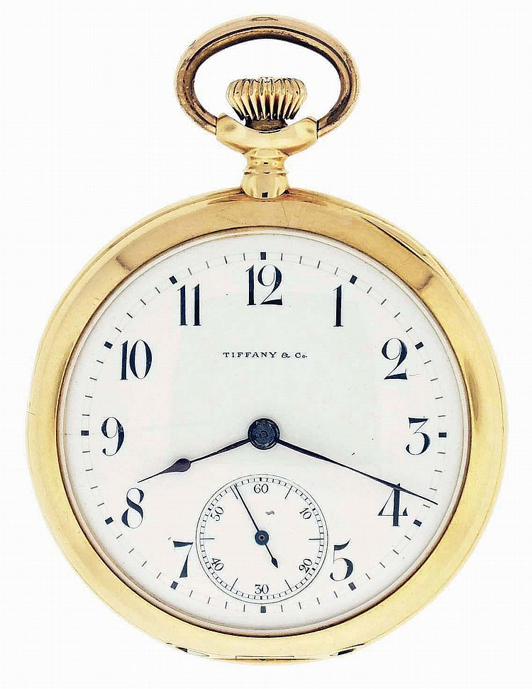Tiffany & Co., New York, NY, man's pocket watch, 16 jewels, stem wind and set, adjusted, cotes de Geneve decorated nickel plate movement with lever escapement, cut bimetallic balance with gold timing screws in an 18 karat, yellow gold, hinged back