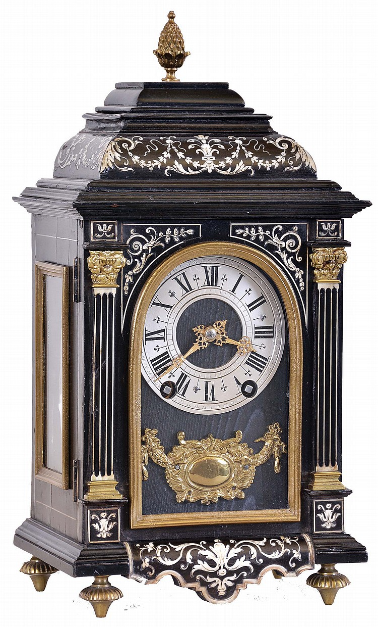 France, for W. Johnson & Son, London, miniature bracket clock, ebonized case with contrasting leaf, vine, and bellflower inlay, front with inlaid pilasters flanking the arched glass, Roman numeral silvered dial with fancy gilt hands, above a gilt