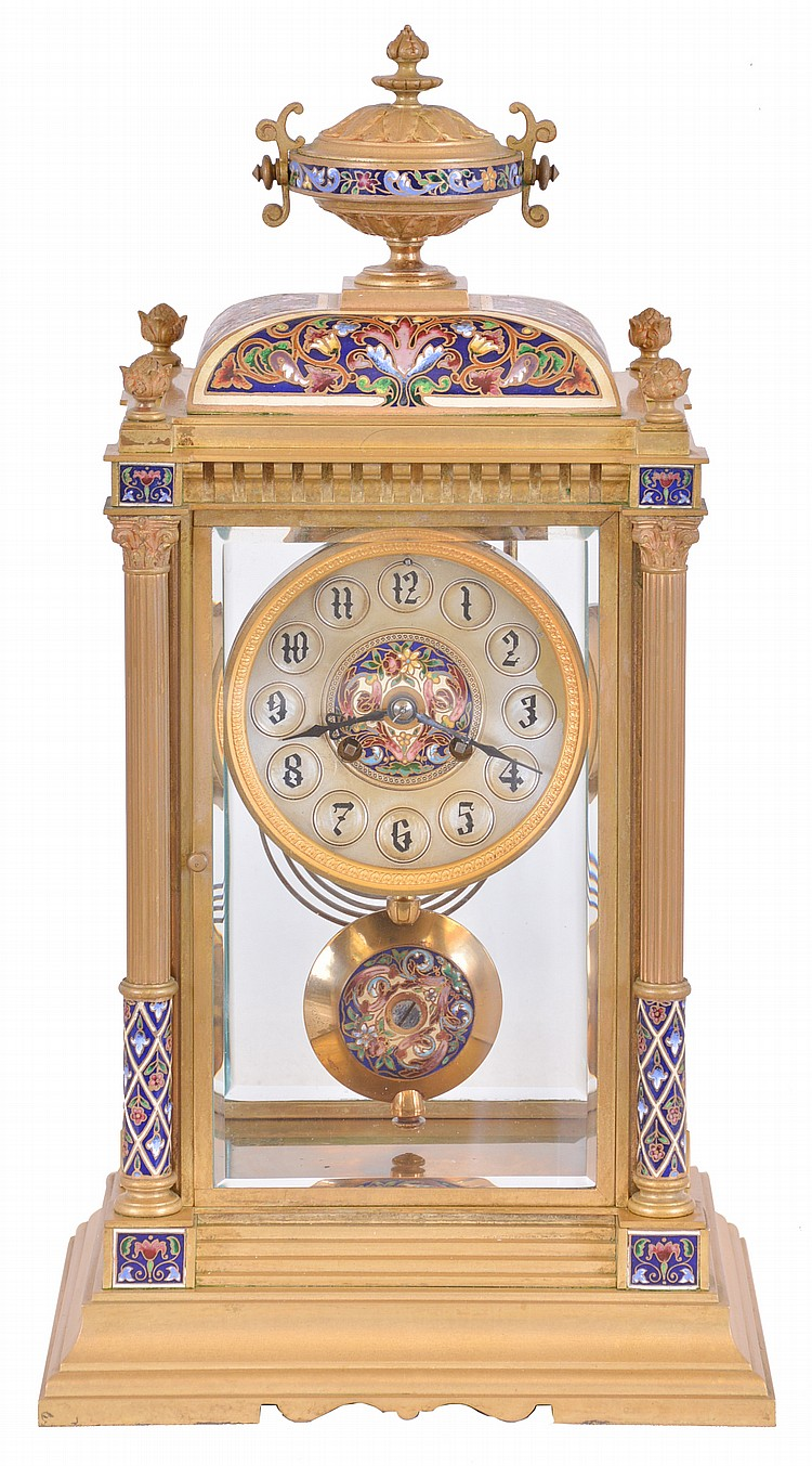 France, crystal regulator, the gilt bronze and champleve enamel decorated architectural case with stepped, molded base, the corners with columns supporting a corbelled cornice, and cushion top surmounted by an urn, silvered concave dial with