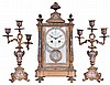 France, for Bigelow, Kennard, & Co., 3 piece mantel garniture, ornate gilt and champleve enamel crystal regulator, Arabic numeral numeral enamel dial with floral garlands, blued steel hands, and brilliant set bezel, 8 day time and strike pendule de