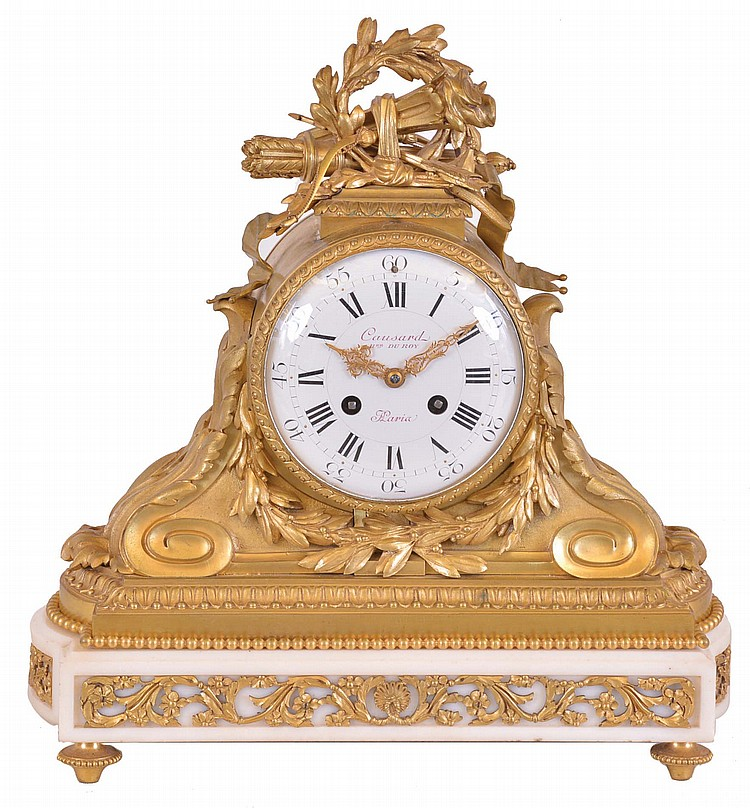 France, a marble and gilt bronze mantel clock, white marble base on gilt feet with recessed panels containing gilt, foliate ornament, the upper section with gilt, acanthus decorated scrolls supporting the cylindrical case, and surmounted by a trophy