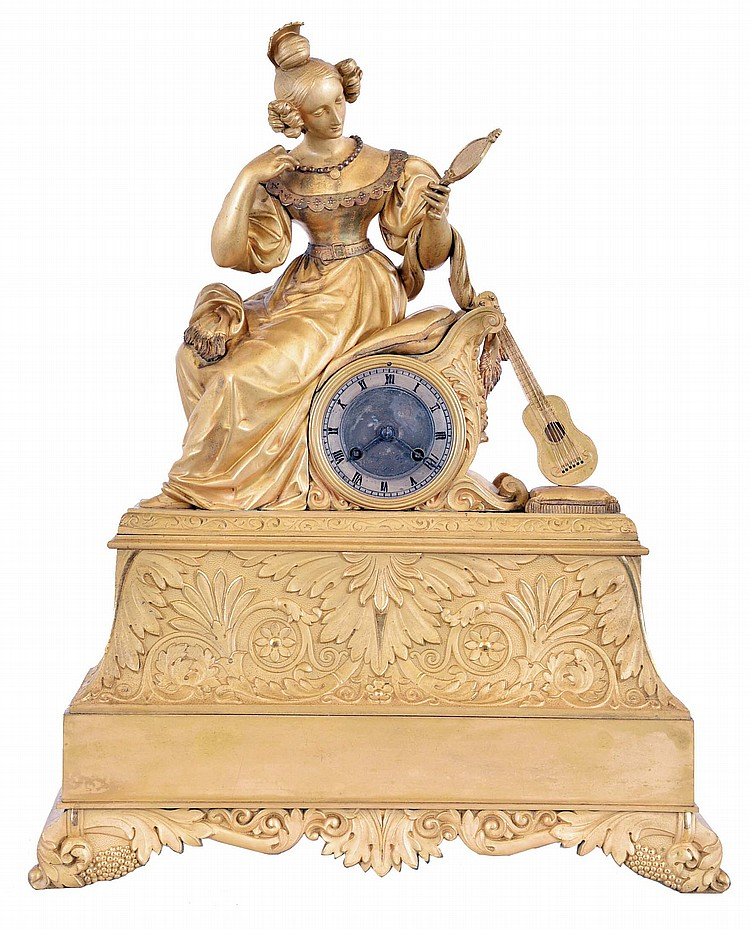 France, a Louis Philippe gilt bronze mantel clock, the case with bright and matte surfaces and decorated with Grecian ornament, surmounted by a figure of a seated young woman with fashionable hairstyle, comb, and dress, admiring her reflection in a