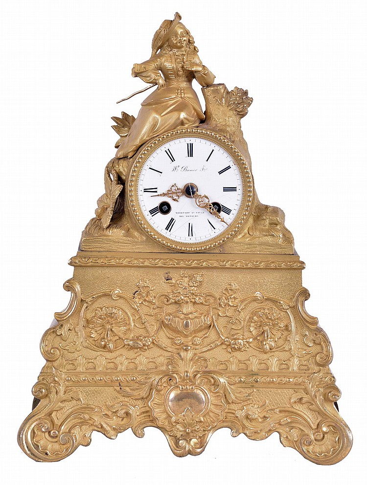 French, 8 day, time and strike spring brass movement with silk thread suspension ormolu figural mantel clock. Dial is marked with a retailer's name: