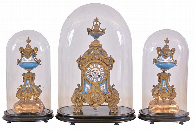France, mantel clock with garniture, ornate, gilt spelter clock case on paw feet, and with polychrome porcelain panels, Roman numeral porcelain dial, blued steel hands, 8 day time and strike pendule de Paris movement, with matching, porcelain mounted