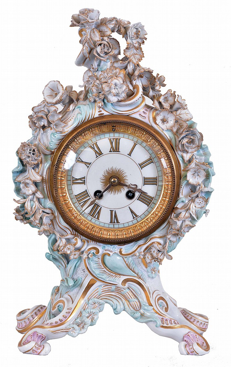 Meissen, Germany, an ornate porcelain mantel clock, the case in pastel colors with gilt accents, with rococo styling and festooned with floral ornament, Roman numeral enamel dial, gilt hands, 8 day time and strike round, French style movement