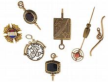Gold items, 10 and 14 karat, including fobs, a fraternal pin, a T- bar for a watch chain, and a stick pin, 14k, 12.0g TW, 10k, 10.3g TW