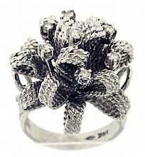 Cocktail ring, 14 karat white gold with loop / bow design, and set with seven small diamonds, size 7, 15g TW