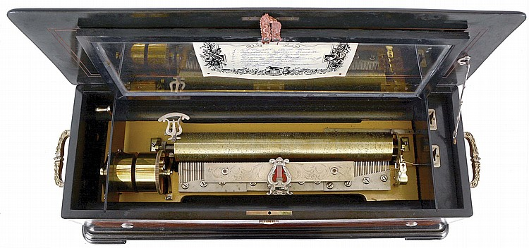 Paillard, Geneva, cylinder music box, ebonized case with burl walnut panels and contrasting, banded borders, turned and carved escutcheon, the ends with ornate brass carrying handles, and the top with central boulle style ornament, the glazed frame