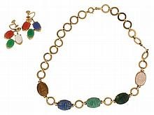 Scarab necklace, 10- 12 karat yellow gold set with carved, semi precious stones, together with a pair of 14 karat yellow gold earrings, each set with three carved stone scarabs, necklace 14