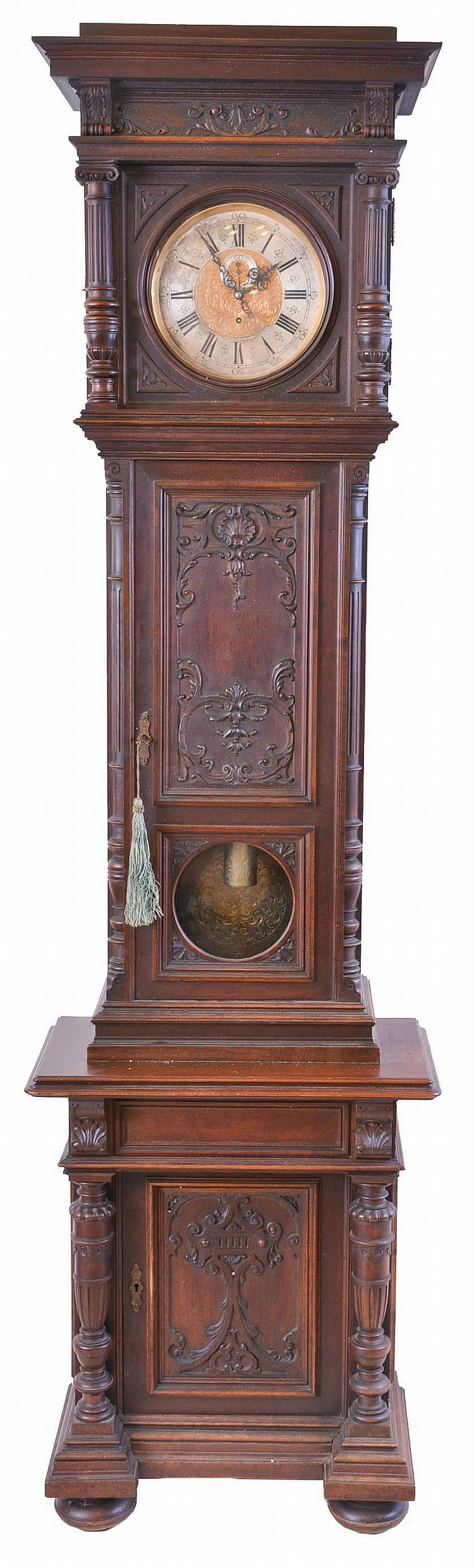 V. Postpischil, Vienna, Austria, long duration tall clock, 30 day, time only, weight driven movement in a carved walnut case with glazed window for engraved pendulum bob, bun feet and cabinet in base. The brass dial has silvered chapter ring is