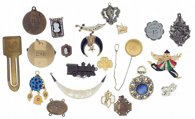 Large lot of costume jewelry and other items including a scent bottle with pin, pendants, watch chains, brooches, watchbands, lockets, and more