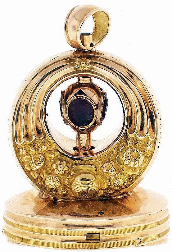 Switzerland, musical watch fob, 22 karat rose gold case with horn of plenty ornament, integral winding key set with four red, oval faceted stones, the nine note musical movement playing on demand, and contained in the oval, banded base, c1820, 19.3g
