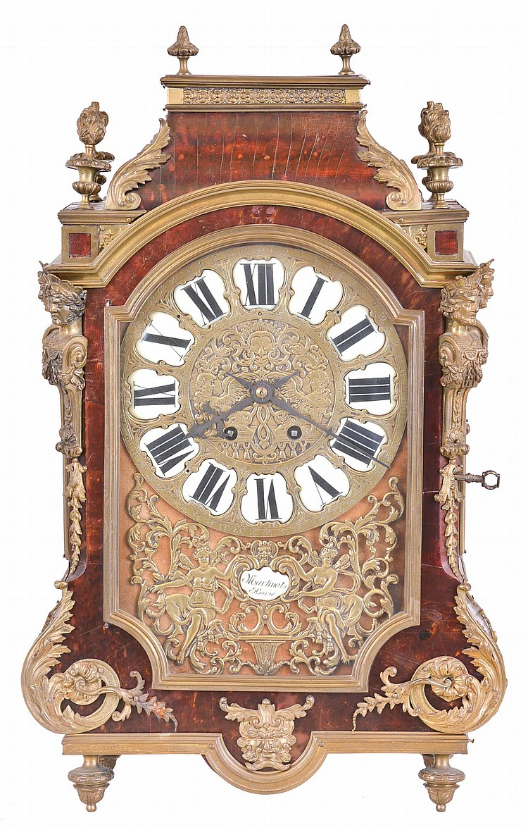 France, a 19th century Religieuse style mantel clock, the case with tortoise shell veneers, brass moldings and cast foliate ornament, corners mounted with half Atlantes figures, and the top with gadrooned flame finials, velvet lined dial with