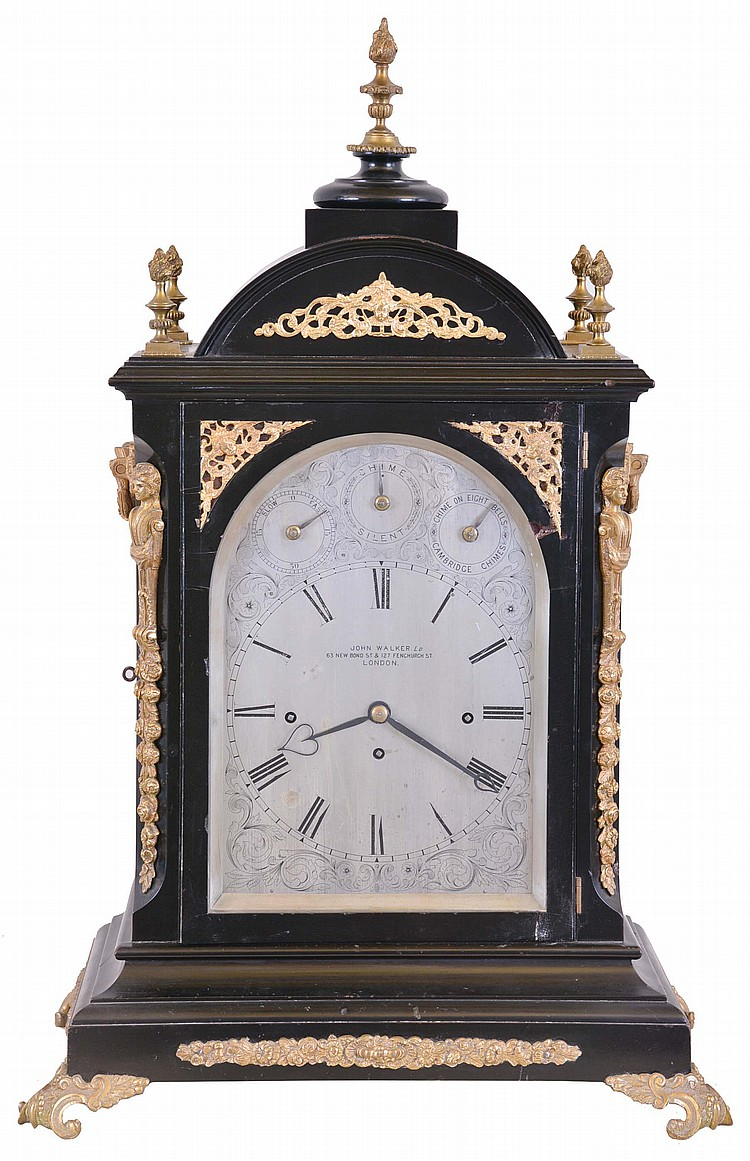 John Walker Ltd., London, large bracket clock, ebonized case with caryatid corners, and set with cast, gilt mounts and ornamental scroll feet, the sides with cast, pierced frets with Helios mask, and foliate ornamented carrying handles, case top with