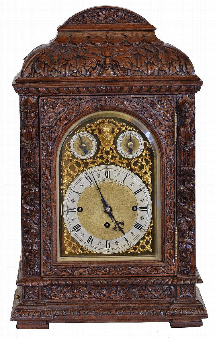 Winterhalder & Hofmeier, Germany, for J.E Caldwell & Co., Philadelphia, a large three train bracket clock, the oak case richly ornamented with low and high relief carving, door with beveled glass, composite dial with Roman numeral chapter ring,