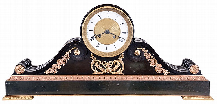 France, for Harris & Harrington, New York, patinated bronze tambour clock, rectilinear base with gilt, foliate ornamented feet and molding, supporting the cylindrical case with flanking scrolls, and also with gilt mounts, Roman numeral white enamel