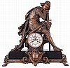 France, a large figural mantel clock, stepped black slate base with bronzed paw feet, laurel molding, and central cartouche with lion mask, supporting the clock case with seated, pensive knight in chain mail and with his sword and dagger, also in a