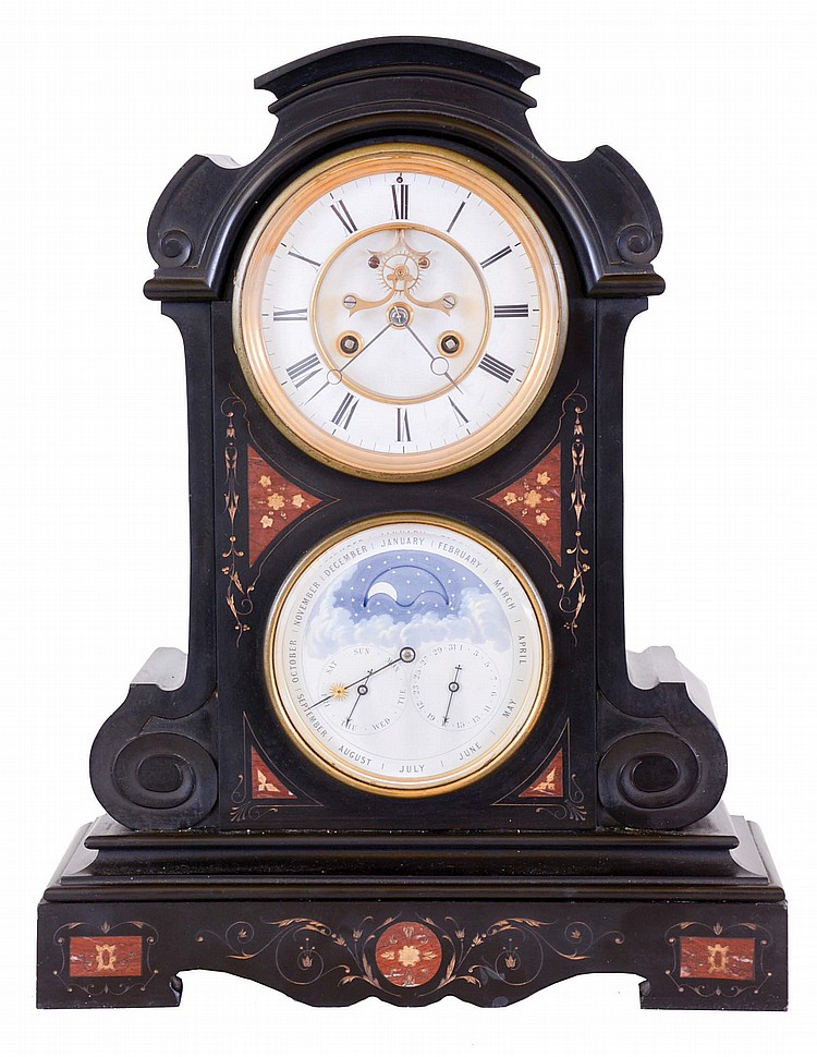 France, two dial mantel clock with Brocot's perpetual calendar, the black slate case with molded base, carved scrolls, red marble inlay, and gilt, incised foliate ornament, Roman numeral white enamel dial with visible Brocot escapement, blued steel