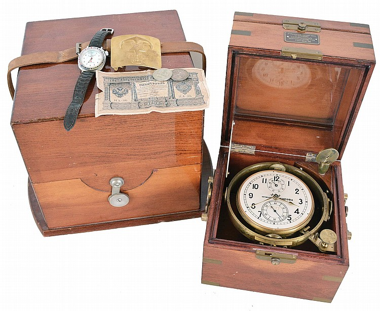First Moscow Watch Factory, USSR, two day marine chronometer, 15 jewel, damascened, gilt movement with fusee, break circuit mechanism, and integral balance with helical hairspring, Arabic numeral silvered dial with gilt spade and poker hands, mounted
