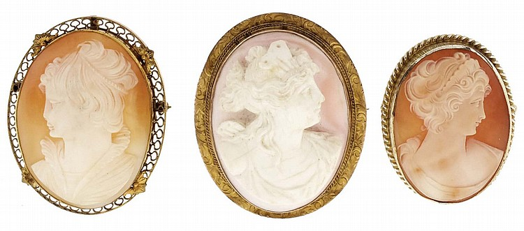 Cameos- 3 (Three), all pin / pendants, all of carved shell and showing young women in profile, two with 10 karat yellow gold frames, and one gold filled, one measures 1 3 / 8