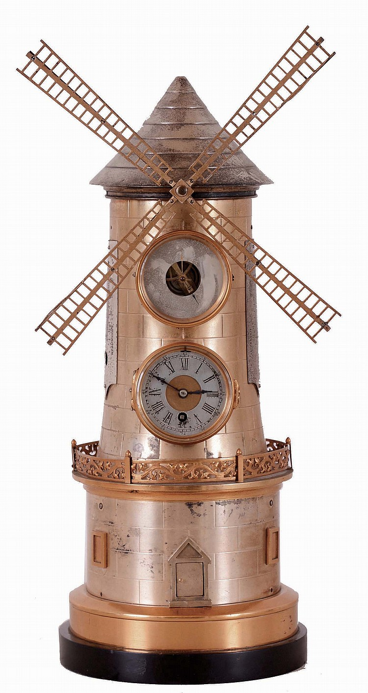 France, industrial series, The Windmill, the gilt and silvered brass case with black slate base, mid section with pierced railing, lower section with two simulated windows flanking a door, the door opening to access the windmill movement winding