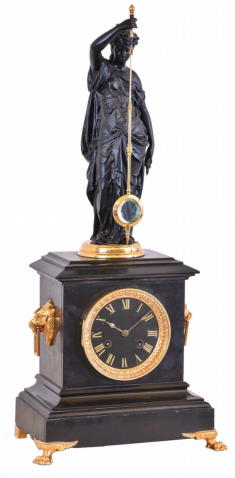 Guilmet, France, mystery clock, black slate case with gilt paw feet and gilt lion mask handles, surmounted by a patinated female figure, her right hand held aloft, and suspending the pendulum, impulsed through the nearly imperceptible movement of the