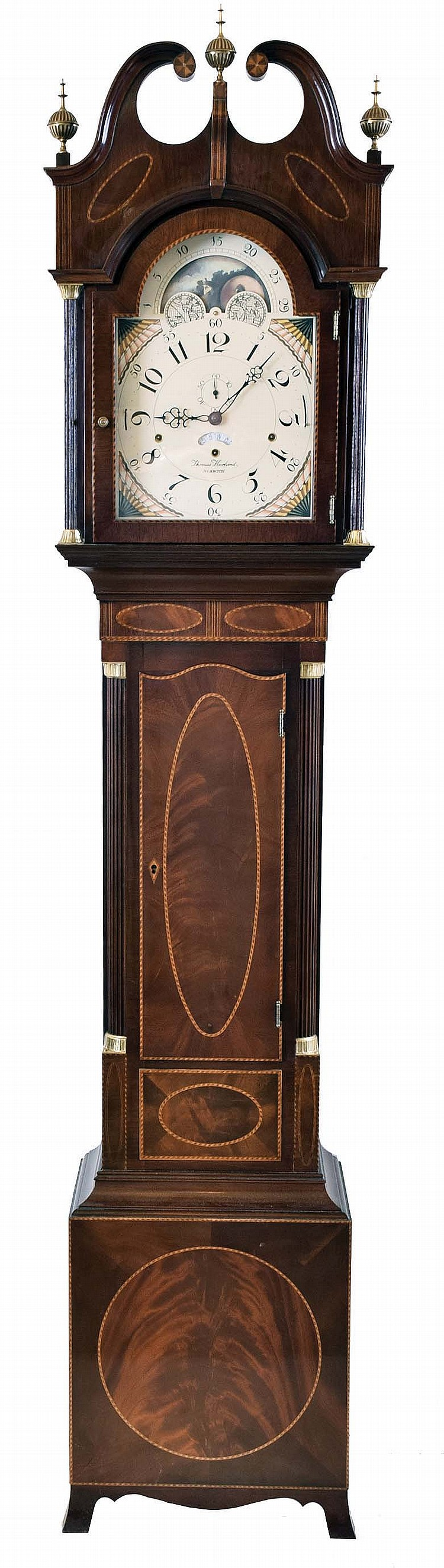 The Henry Ford Museum, Dearborn, Michigan reproduction by Sligh signed Thomas Harland, Norwich Conn., tall case clock, 8 day, time, strike and triple chime, weight driven movement in a mahogany Hepplewhite style case with three brass finials, full