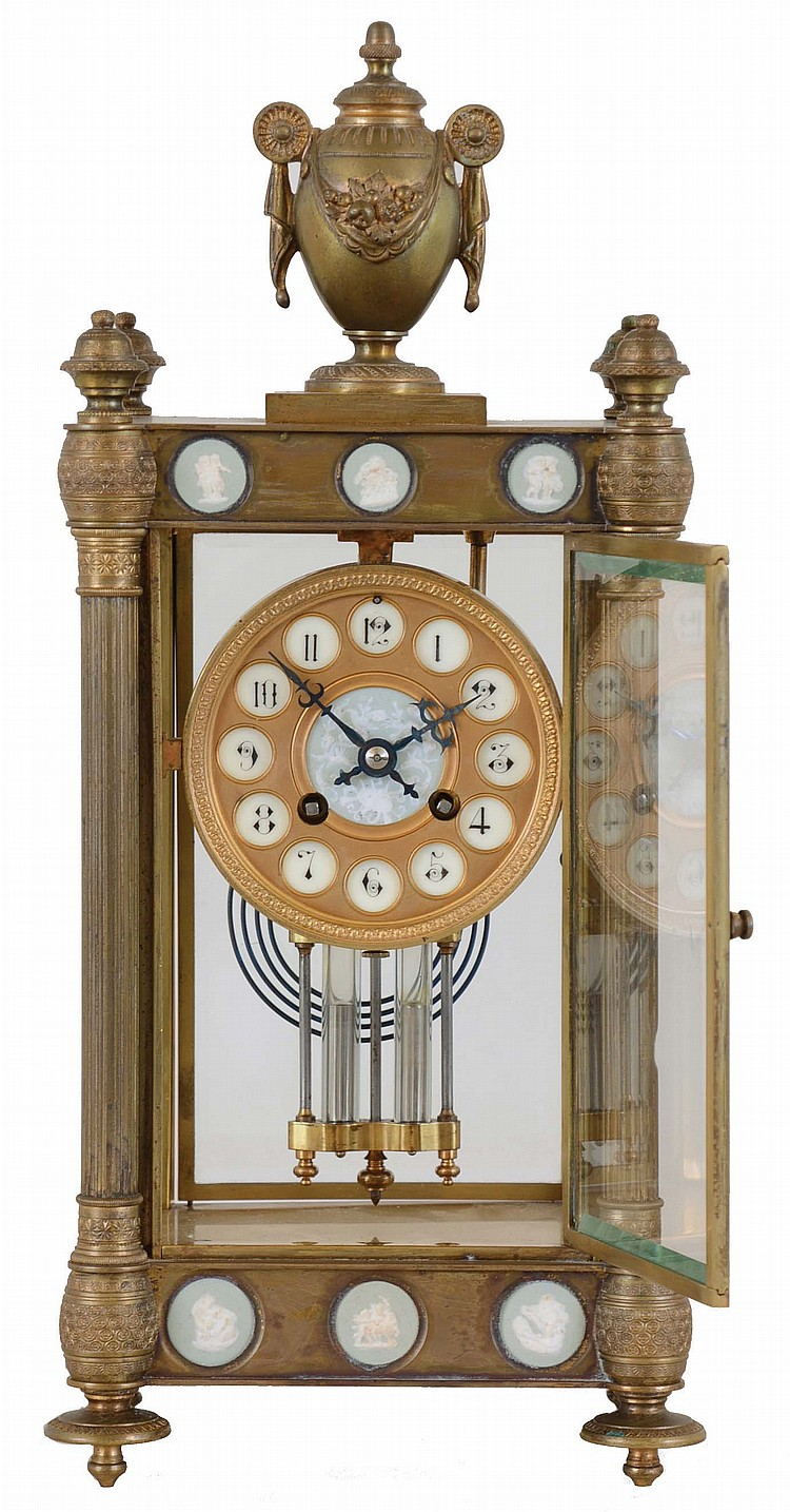 French, Marti & Cie, 8 day, time and strike spring brass movement crystal regulator with small wedgewood panels in the top and base.