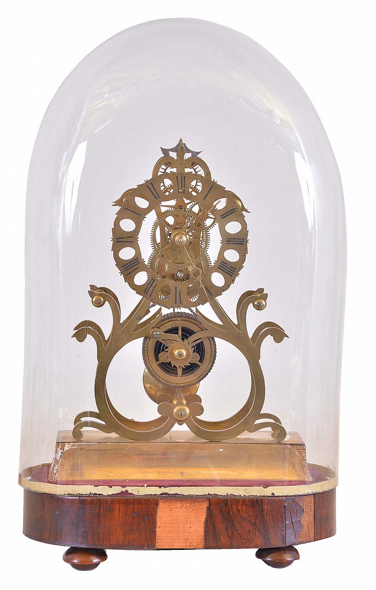 England, skeleton clock, the eight day fusee timepiece with nicely designed and executed scroll frames, the pattern similar to those used by Condliff for their great wheel clocks, Roman numeral brass dial with scalloped edge and oval piercing, brass
